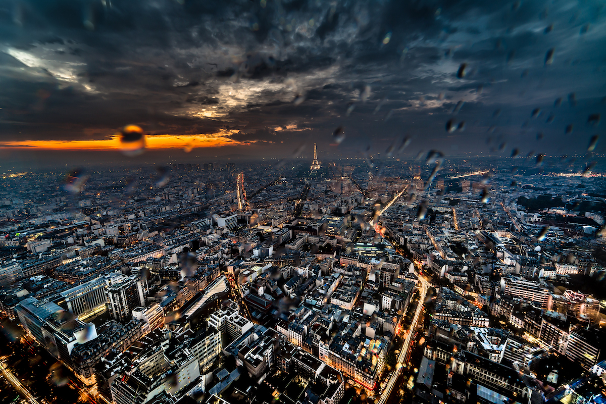 Best places to take pictures in Paris - Paris Sunset in the Rain. Taken from the Tour Montparnasee with a Canon 6D and Rokinon 14mm f/2.8