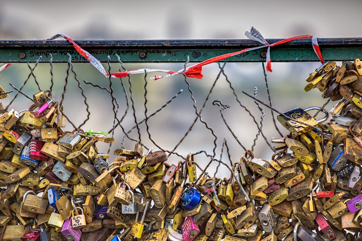 Best places to take pictures in Paris - I love you to the point of total destruction. Pont des Arts Bridge, Paris. Taken with a Canon 6D and Canon EF70-200mm f/2.8L IS USM lens.
